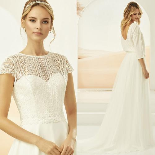Frau trägt ein Mix and Match Hochzeitskleider mit separatem Spitzenbolero und Brautrock